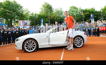 Czech Tomas Berdych smiles in front of his new BMW Z4 convertible that he won in the final match against Russian - Stock Photo