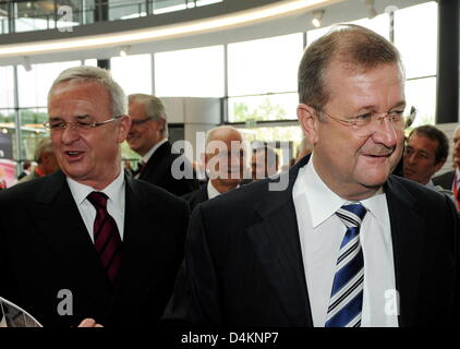 CEO of Audi, Martin Winterkorn (L) and CEO of Porsche, Wendelin Wiedeking meet at the Audi general meeting in Neckarsulm, - Stock Photo