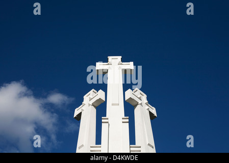 Low angle view of crosses and blue sky - Stock Photo