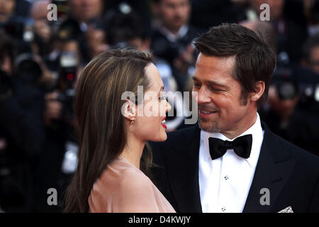Brad Pitt and Angelina Jolie arrive for the world premiere of the film ?Inglorious Basterds? at the 62nd Cannes - Stock Photo