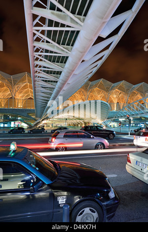 Portugal, Lisbon: Nocturnal traffic and illumination at station Garé do Oriente - Stock Photo
