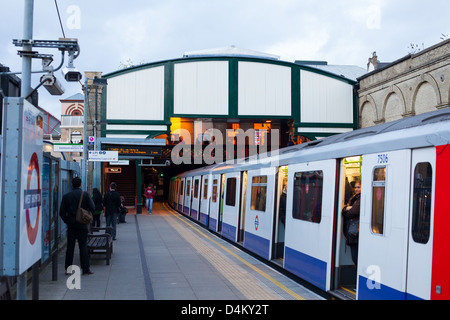 London tube train standing at station West Brompton District Line. - Stock Photo