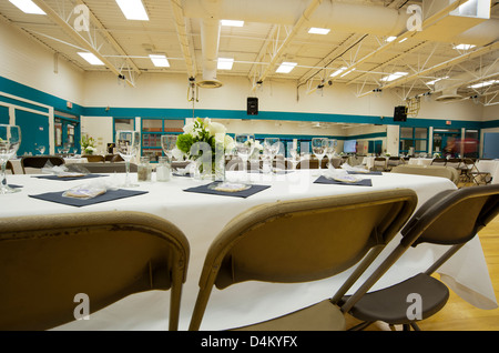 Tables And Chairs Set Up For Wedding Reception In A Big Public Auditorium