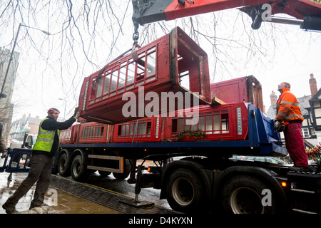 Telephone boxes being removed from the streets in UK towns now that their popularity has waned due to mobile phone - Stock Photo