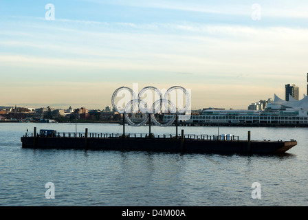 Olympic rings  for 2010 winter olympics on a barge in the harbour at Vancouver, British Columbia, Canada - Stock Photo