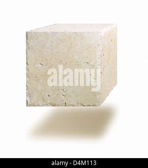 Marble cube floating in air against white background - Stock Photo