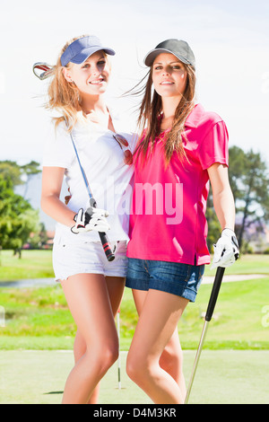 Women smiling together on golf course