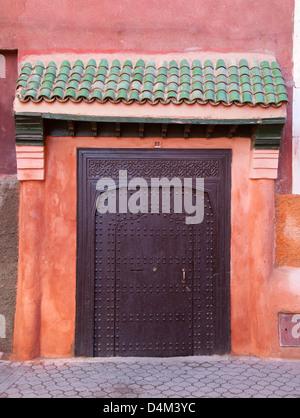 Ornate metal door on village street - Stock Photo
