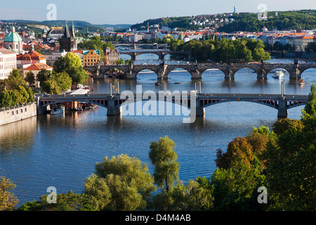 View of Prague and bridges over river Vltava (Moldau) Czech Republic. Famous Charles Bridge is second from bottom. Stock Photo