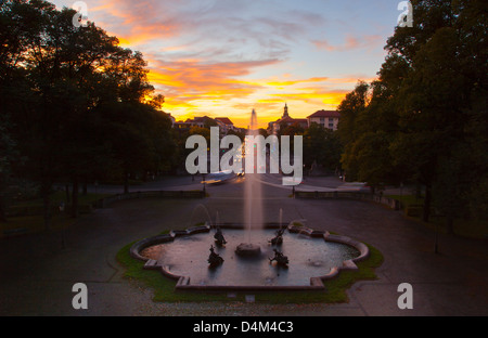 Ornate fountain in town square at dusk - Stock Photo