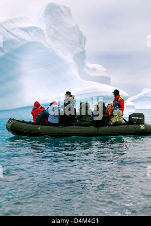 Tourists cruising among icebergs in Antarctica