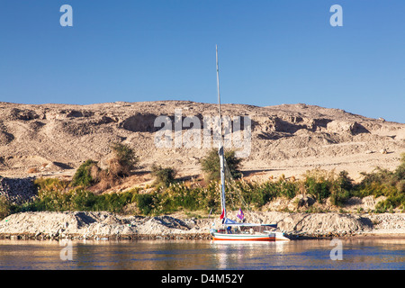 Tourist felucca moored along the bank of the Nile near Aswan. - Stock Photo