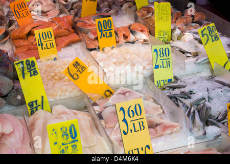 Fishmonger's fish display with salmon and other fish steaks in Chinatown, New York - Stock Photo