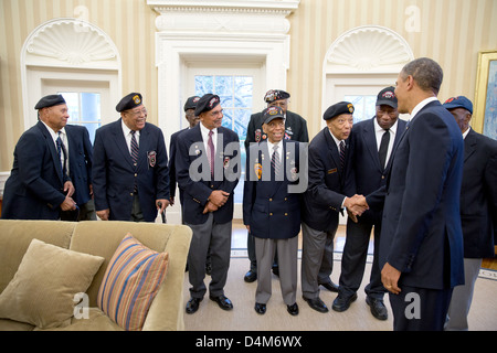 US President Barack Obama greets veterans of the 2nd Airborne Ranger Infantry Company in the Oval Office of the - Stock Photo