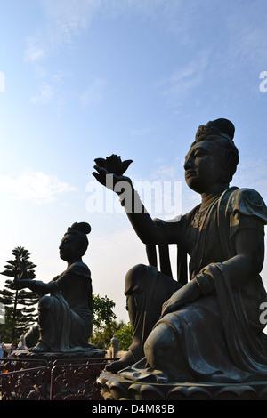 The Offering of two of the Six Devas to the Tian Tian Buddha (Big Buddha) Lantau Island, Hong Kong, China - Stock Photo