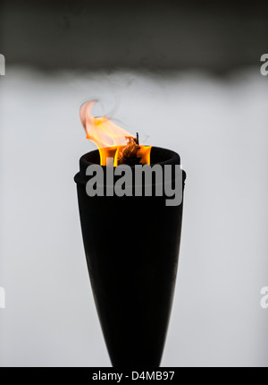 A wicked, oil-burning flaming torch or brand - Stock Photo