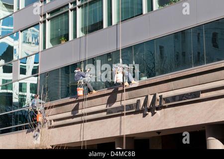 High rise window cleaners - USA - Stock Photo