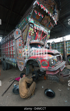 Islamabad, Pakistan, man goes on a truck coming from the brakes - Stock Photo