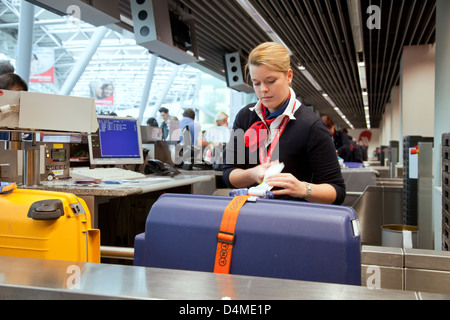 Duesseldorf, Germany, ground staff at airberlin check-in desk at the airport Duesseldorf International - Stock Photo