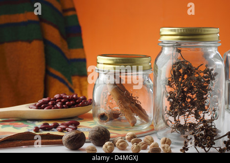 spice and herbs jars on table kitchen - Stock Photo