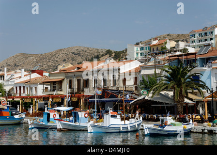 Samos. Greece. The Pythagoreio waterfront bursting with restaurants, cafes and colourful fishing boats docked in - Stock Photo