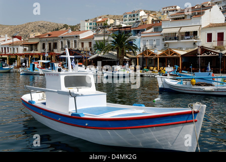 Samos. Greece. Colourful fishing boats docked in the pretty harbour of Pythagoreio. - Stock Photo