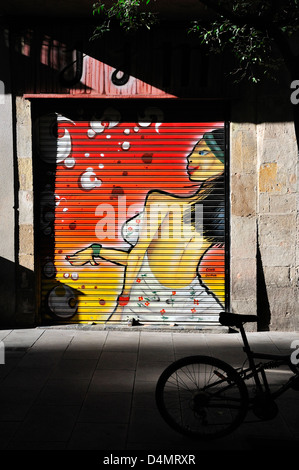 Barcelona, Catalonia, Spain. Painted garage shutters - Stock Photo
