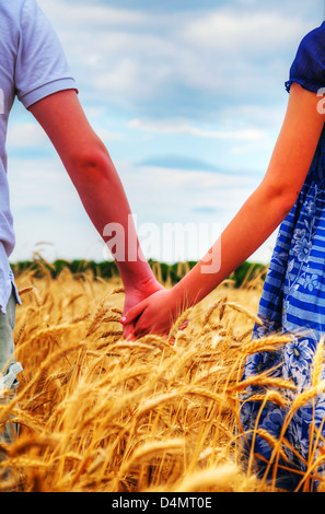 Young couple holding hands in the evening - Stock Photo