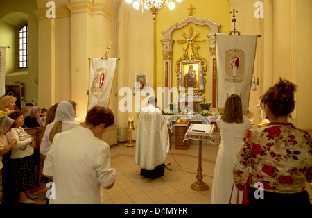 Lviv, Ukraine, believers in a church service before the icon of the Mother of God