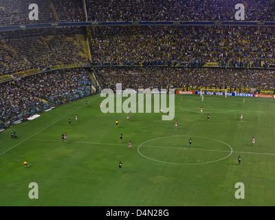 Boca Juniors play a football match at the famous La Bombonera stadium in Boca in Buenos Aires, Argentina - Stock Photo
