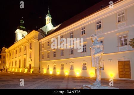 City Hall, left, baroque Jesuit Church in the right, Main Square, Sibiu, Transylvania, Romania, Europe - Stock Photo