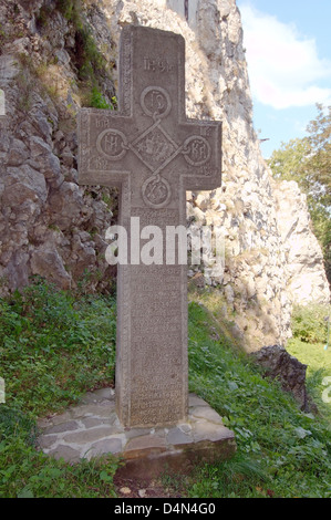 Stone cross placed in front of the Bran Castle (Castelul Bran) - Count Dracula's Castle, Braşov, Wallachia, Romania - Stock Photo
