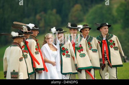 Polish wedding party in traditional costume. - Stock Photo