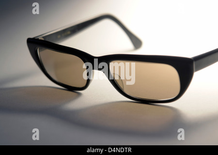 70s sunglasses in atmospheric ambiance - Stock Photo