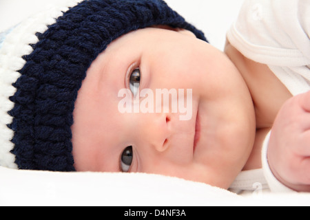 baby in knitted hat - Stock Photo