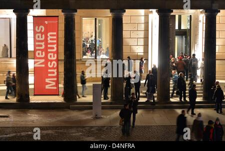 Visitors walk to the entrance of the Neue Museum (New Museum) during the 32nd Long night of the museums in Berlin, - Stock Photo