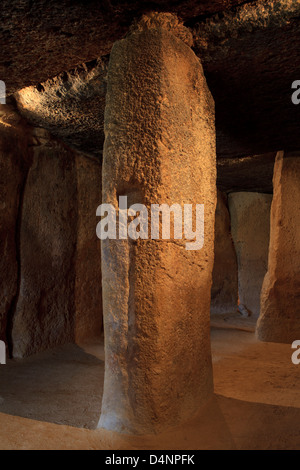 The access corridor and main entrance to the burial chamber of the Dolmen of Menga (3000 BC) in Antequera, Spain - Stock Photo