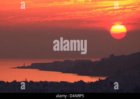 Amazing sunset over Nerja on the Costa del Sol in the Province of Malaga, Spain - Stock Photo