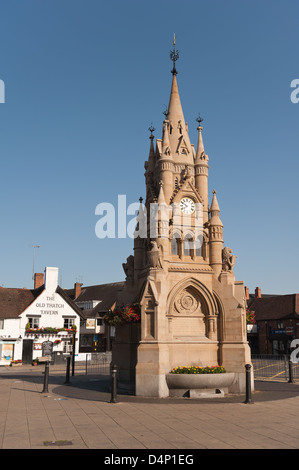The American Fountain clock monument in the center of Stratford upon Avon on market square link with USA early morning - Stock Photo