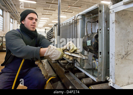 Berlin, Germany, the employee BRAL disassembled old fridges - Stock Photo