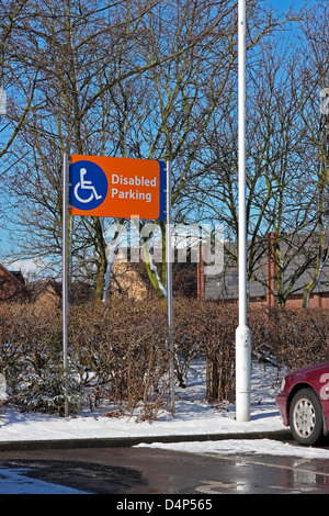 Disabled parking sign in a supermarket car park - Stock Photo