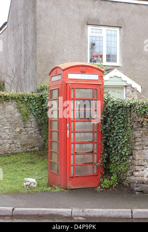 Traditional red British telephone box, now falling into disuse with everyone carrying a mobile phone, February 2013 - Stock Photo
