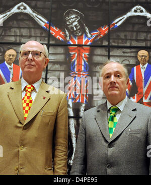 Artist duo George (L) and Gilbert (R) pictured in front of their work ?Church of England? in Berlin, Germany, 12 - Stock Photo