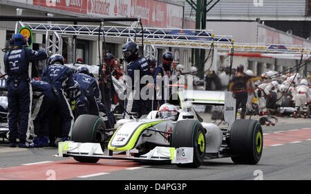 British Formula One driver Jenson Button of Brawn GP comes to a pit stop during the British Grand Prix at Silverstone - Stock Photo