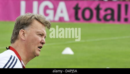 Louis van Gaal, new head coach of German Bundesliga soccer club FC Bayern Munich, is pictured in front of a banner - Stock Photo