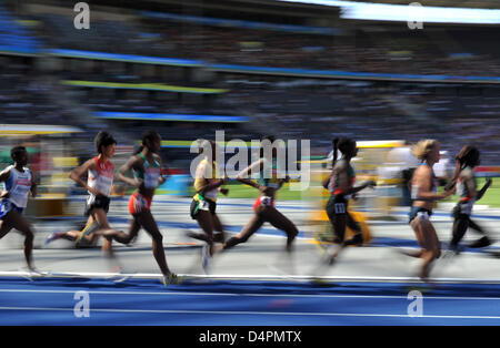 Athletes shown in action during a women?s 5000m heat at the 12th IAAF World Championships in Athletics, Berlin, - Stock Photo