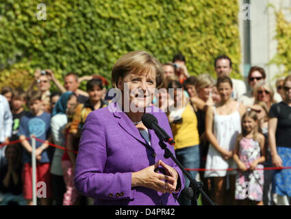 German Chancellor Angela Merkel welcomes visitors during the annual ?Open Doors Day? at the Chancellery in Berlin, - Stock Photo