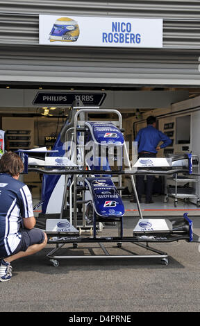 Mechanic of Williams work on the car of German Formula One driver Rosberg in the pits in Spa-Francorchamps, Belgium, - Stock Photo