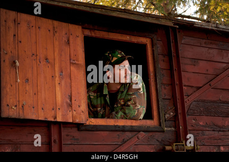 Young man in camouflage clothes - Stock Photo