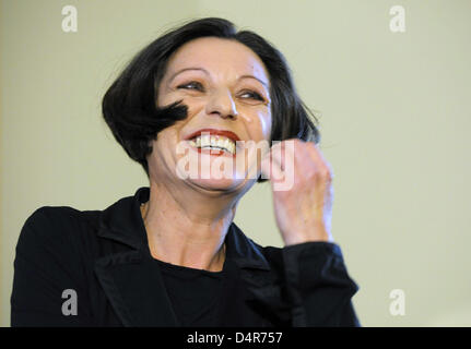 Nobel Prize laureate Hertha Mueller laughs on the podium during a press conference in Berlin, Germany, 08 October - Stock Photo